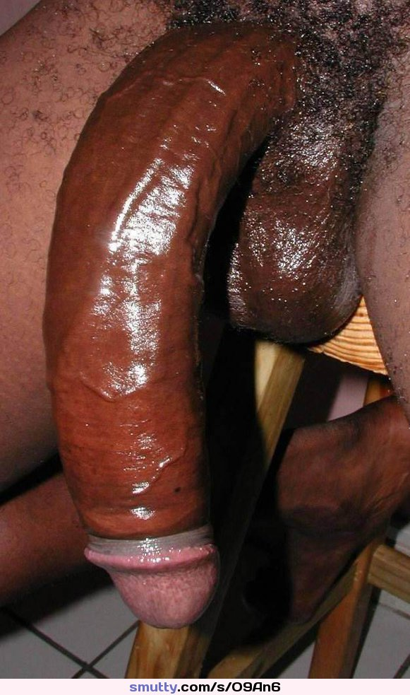 Fat guy with big black dick on bed