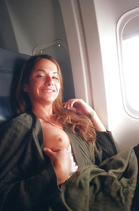 Flight attendant flashing boobs