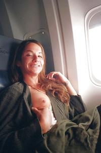 Flight attendant flashing boobs