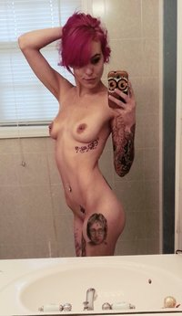 Hot slapper with tattoos teasing in mirror