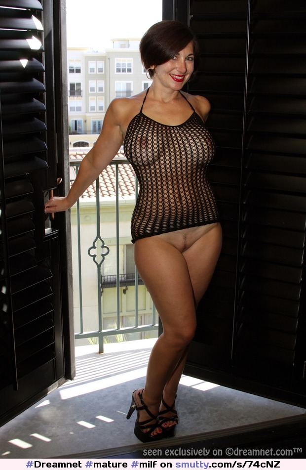 Nude milf covering tits