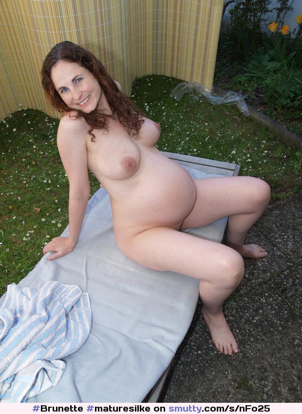Amateur brunette sitting on a black dildo 6