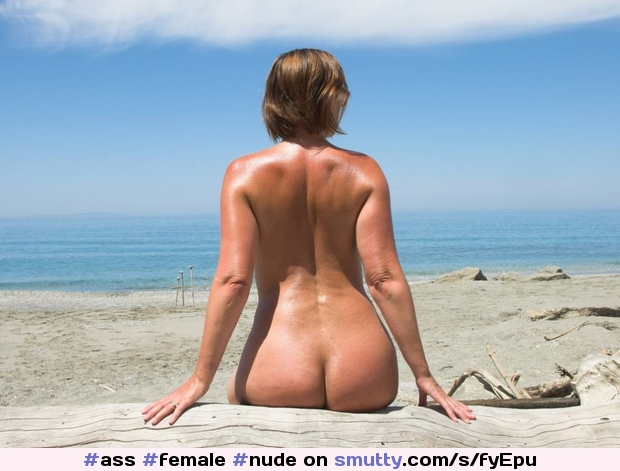 Butt naked woman on the beach