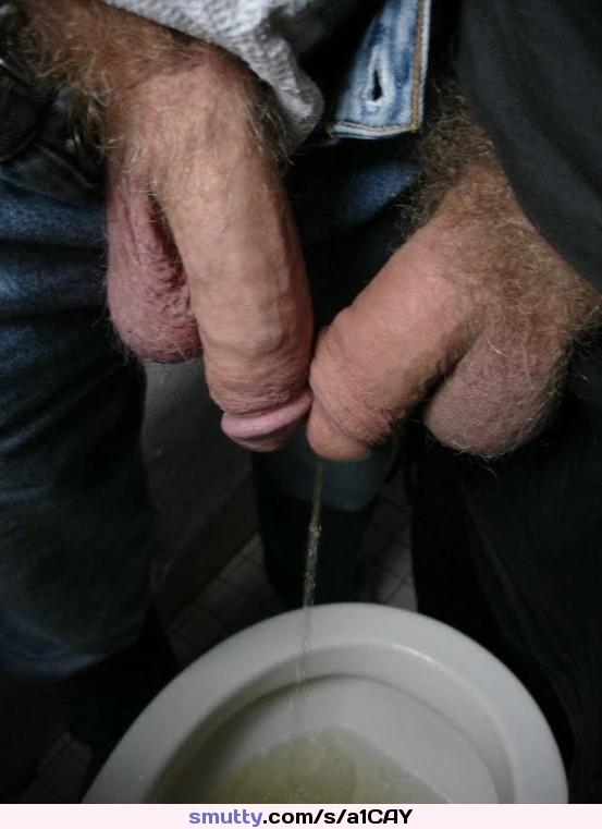 Men piss together