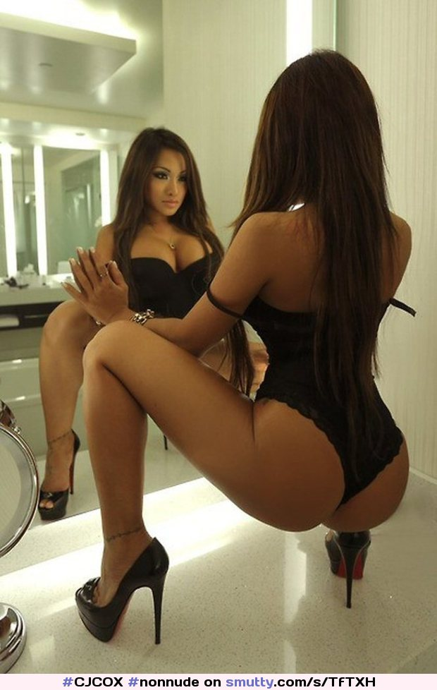 Busty Asian in Lingerie and Heels in front of mirror