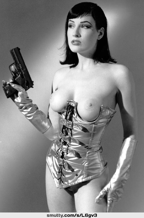 #DitaVonTeese #corset #gloves #breasts #tits #boobs #gun #handgun