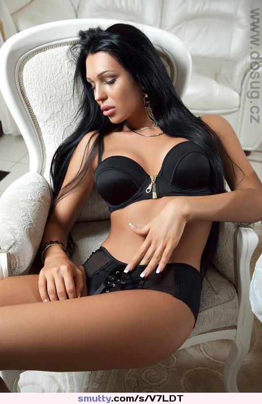 Beautiful and sexy brunette girl on dark stock photo
