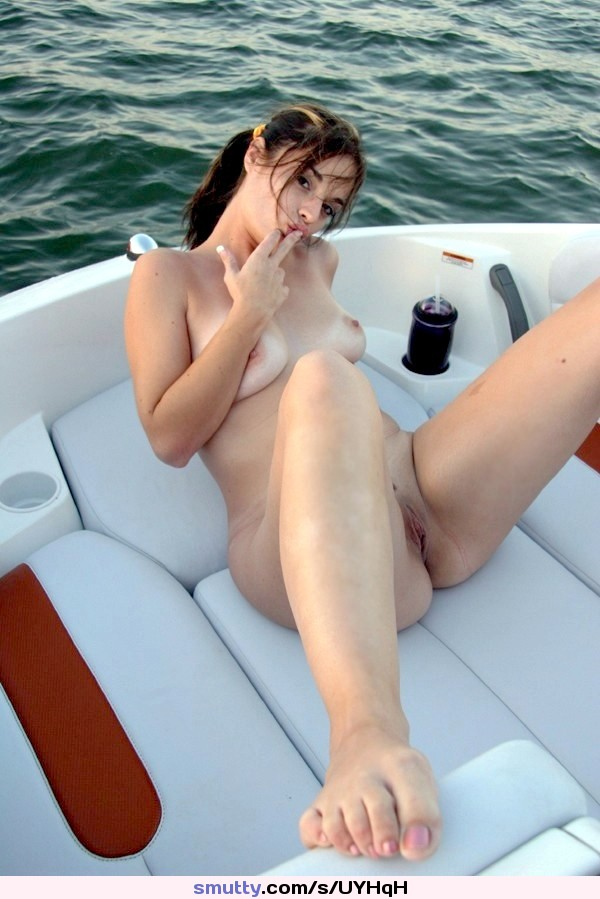 Sexy half naked chick on boat