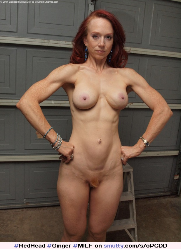 Naked fit redhead with big round boobs