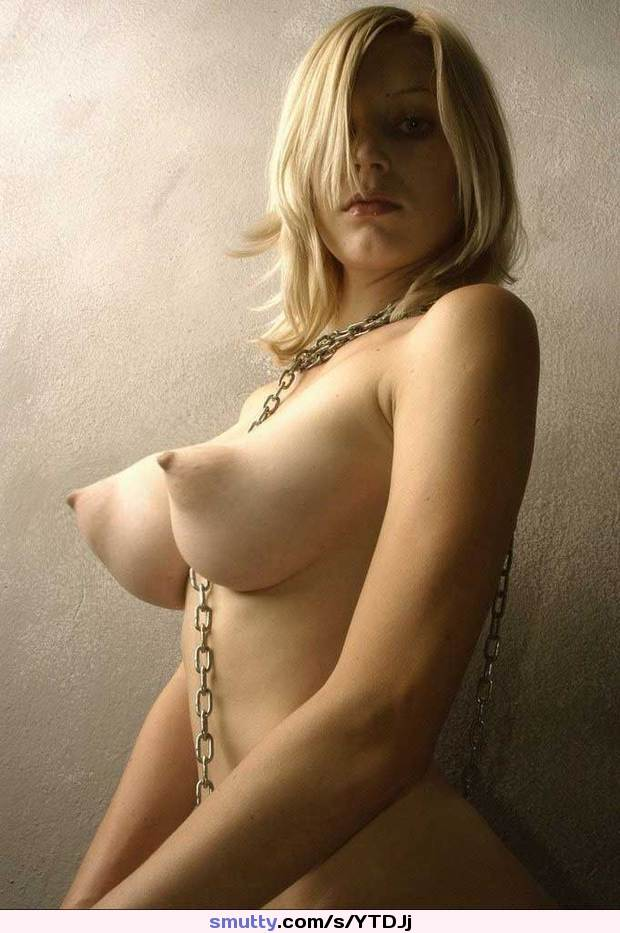 Sexy blonde cougar with big boobs