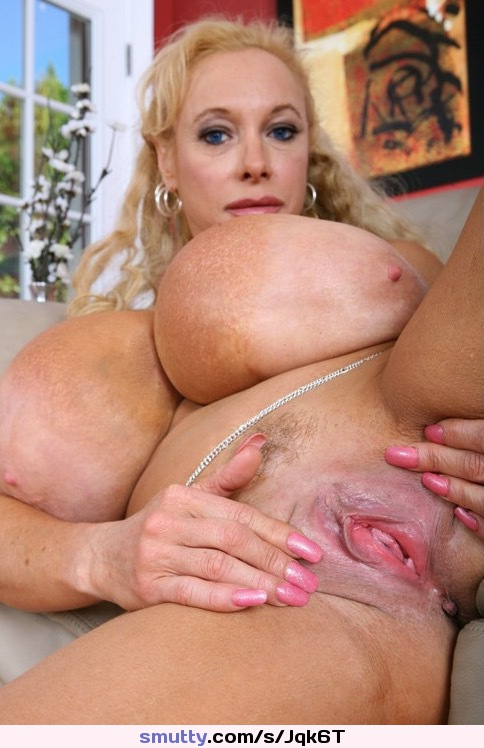 Naked babe with big tits gets her pussy pumped