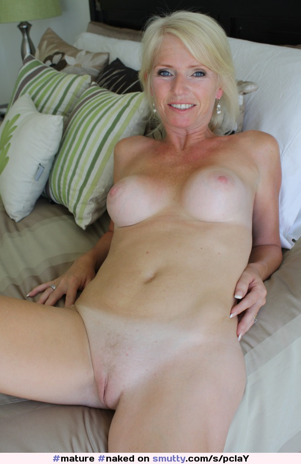 Mature and curvy blonde babe reveals her tasty shaved pussy