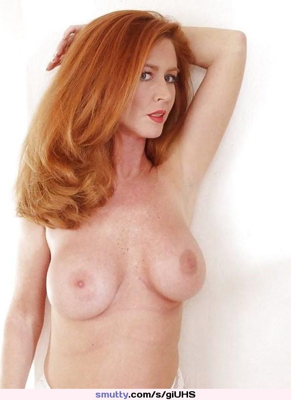 Dreamy redhead woman posing on street portrait, trendy