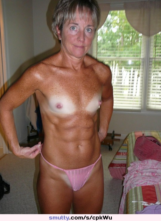 #granny #gramma #mommy #milf #blueeyes #shorthair #grayhair #smallboobs #muscular #wow #shape #abs #tanlines #pinkpanty