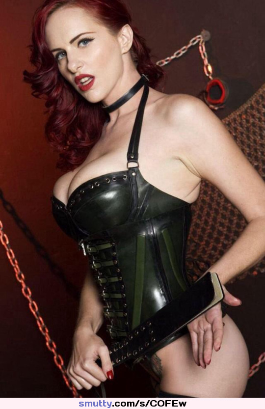 Redhead dominatrix mistress in leather