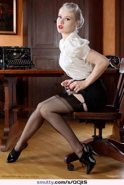 Caught adjusting her #stockingtops - #officegirl #secretary #stockings #stockingsandsuspenders #pinup #posing